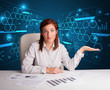 Businesswoman doing paperwork with futuristic background