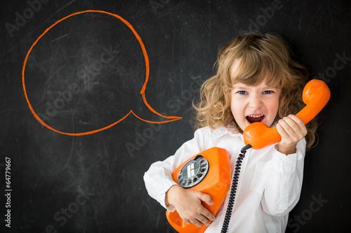 Leinwanddruck Bild Kid shouting through phone