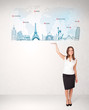 Business woman presenting map with famous cities and landmarks