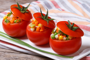 Fresh tomatoes stuffed with vegetable salad