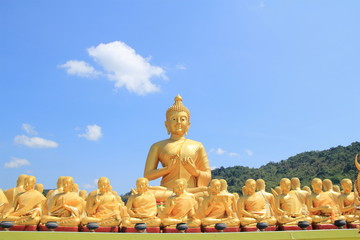 buddha and monk statue