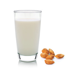 glass of milk and almond isolated on white background