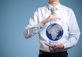 Businessman holds or holding world earth in hand
