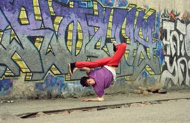 Teenager dancing in the street