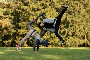 Friends dancing break dance in the park