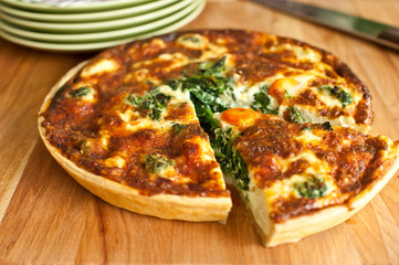 spinach quiche on a wooden plate