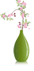 cherry branch in a green vase