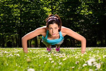 Woman doing push ups fitness workout