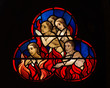 canvas print picture - Stained glass window of people burning in hell