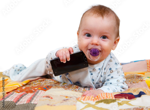 Little boy with dummy holding smartphone