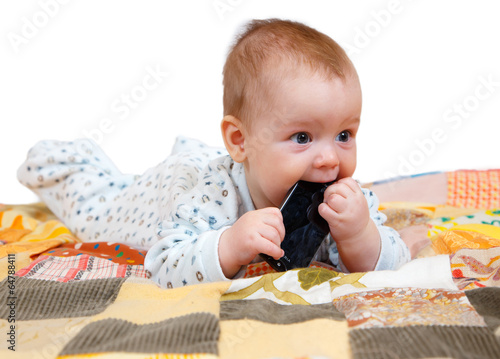 Baby with smartphone in his mouth