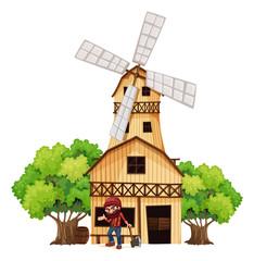 A woodman holding an axe beside the wooden building