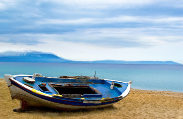 fishing boat on beach sand ocean morning sky