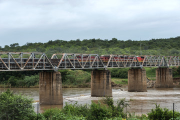 old train crossing the elephants river in south africa