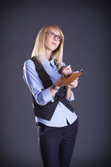 Beautiful young blond woman with a notepad in hand