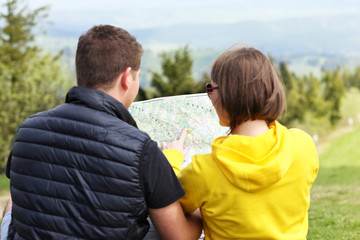 Young couple with map