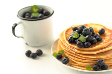 Stack of pancakes with fresh blueberries fruits and honey