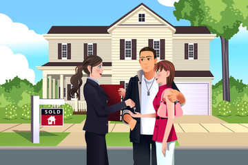 Real estate agent in front of a sold house with her customer