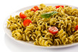 Pasta with pesto sauce, parmesan and vegetables