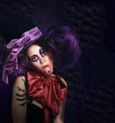 Burlesque. Humorous Comedian in Stagy Hat Showing Tongue