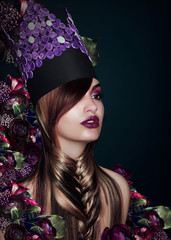 Outlandish Fashion Model in Theatrical Colorful Hat
