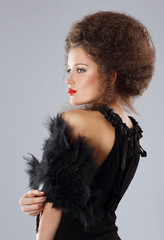 Glamorous Brunette with Frizzy Hairs in Evening Dress