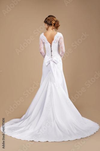 Holiday. Rear View of Auburn Woman in Long Festive Dress
