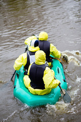 People in overcrowded rubber boat