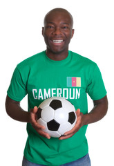 Laughing soccer fan from Cameroon with ball