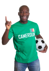 Happy soccer fan from Cameroon with ball