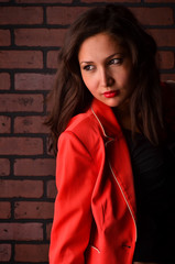 Photo of an attractive young woman in red jacket