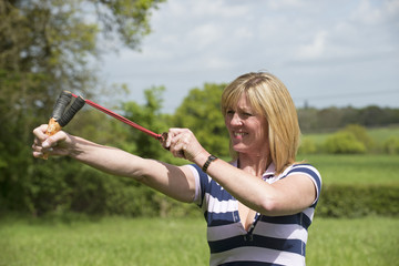 Woman firing a catapult