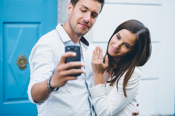 Young couple taking a selfie after engagment proposal