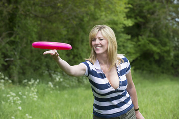 Woman throwing a flying disc