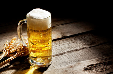 Glass of light beer with spikelets