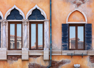 Old arched windows of Venetian house