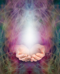 Healer's cupped hands and energy manifestation