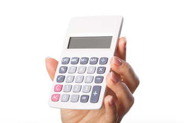 Woman's hand holding calculator
