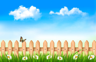 Wooden fence in grass with flowers and a butterfly. Vector.