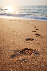 Footprints on the beach sand.Traces on the beach. Footsteps on t