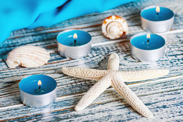 candles seashells on a wooden table
