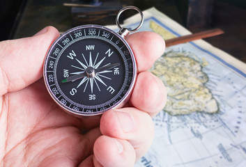 compass in hand paves the route map