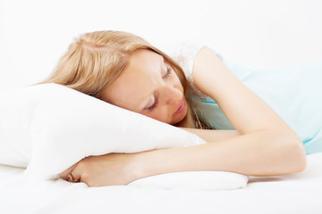 girl  sleeping on white pillow