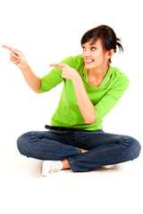 young woman pointing showing something