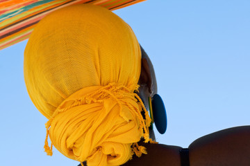 African woman with yellow head scarf