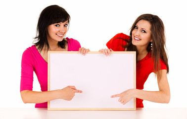 two young women with whiteboard