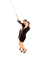 two young business woman, pulling the rope