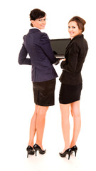 two happy young business women with laptop