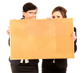 two young business women holding the cork board