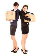 two young business women with carton boxes